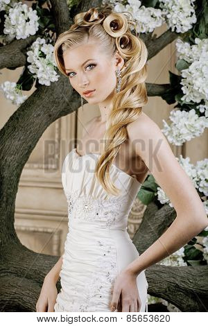 beauty young bride alone in luxury vintage interior with a lot o