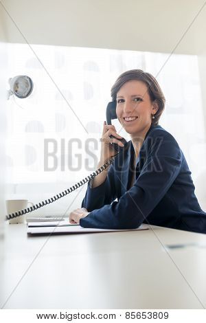 Businesswoman In Blue Suit Calling Someone Through Telephone