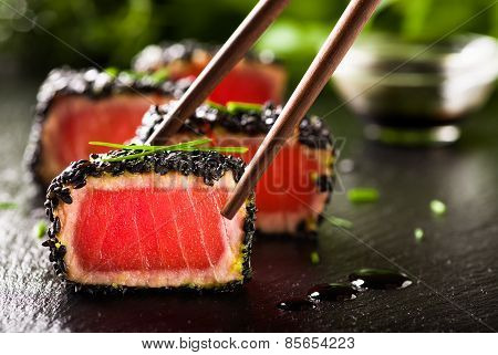 Fried Tuna Steak In Black Sesame With Chopsticks