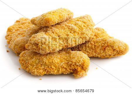 Pile of frozen bread crumbed chicken strips on white.