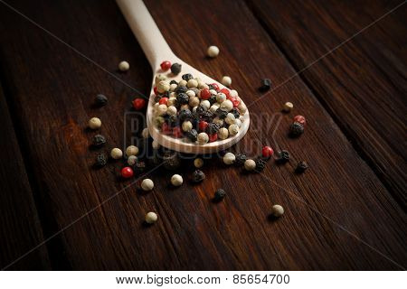 Mix Of Pepper Seasoning In A Wooden Spoon