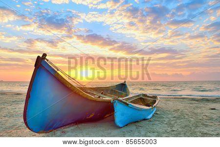 Fishing boats and sunrise on Black Sea