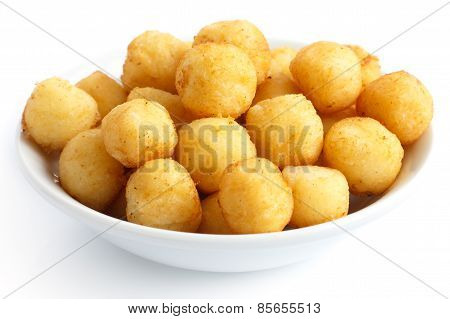 Golden fried small potato balls.