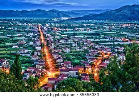 Aerial View Of A Small Croatian Town In The Night With Bright Lighted Streets. Hdr Image
