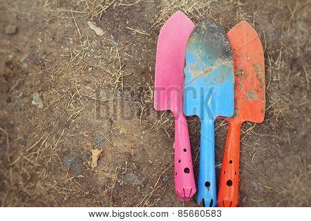 Shovel And Fork For Gardening On Soil Background