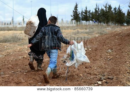 Boy with his grandmother illegaly entering into Turkey.