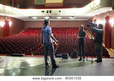 MOSCOW - MAR 12, 2014: Interview with actor of Taper-show on stage of the Palace on Yauza