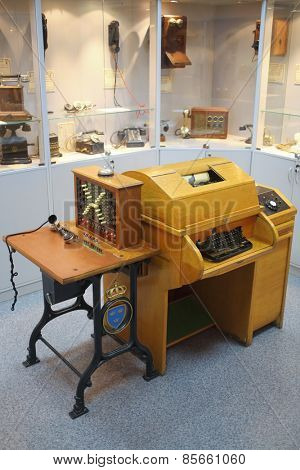MOSCOW - APR 05, 2014: Transceiving telegraph with the keyboard, when receiving a message is automatically recorded letters and commutator in the Museum of the History telephone in Moscow
