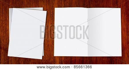 Blank catalog, magazines,book mock up on wood background  ( with separate layer clipping path : Front book,Left page,Right page,and Staple)