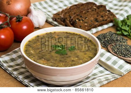 Lentil stew with bread and vegetables