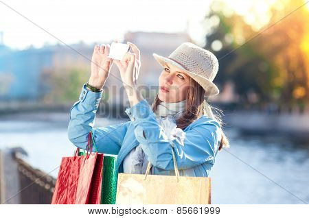 Beautiful Girl With Shopping Bags Taken Picture Of Herself In The City