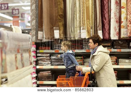 Granmother With Grandchild At Supermarket