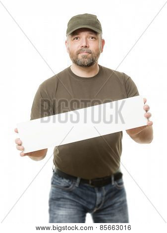 An image of a bearded man holding a white board