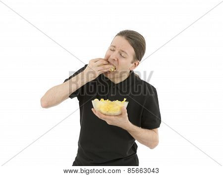 Man Eating A Bowl Of Chips