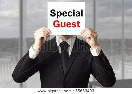 Businessman Hiding Face Behind Sign Special Guest