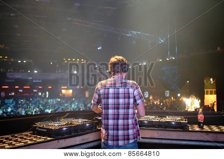 MOSCOW - APR 05, 2014: DJ spinning the decks at the Trancemission in Stadium Live, view from the back