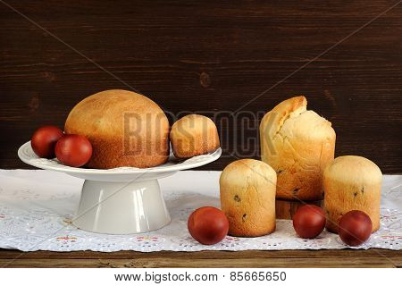 Kulichi, Traditional Russian Easter Cakes And Dyed Eggs On White Cloth