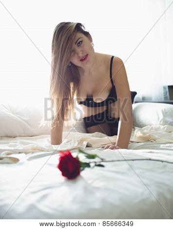 Slim Woman In Lingerie Posing On Bed Next To Window