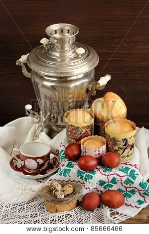 Kulichi, Traditional Russian Easter Cakes With Samovar, Dyed Eggs And Bird Nest On Handmade Rushnik