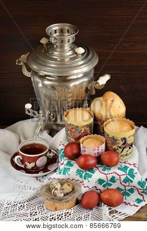 Kulichi, Traditional Russian Easter Cakes With Samovar, Black Tea And Dyed Eggs On Handmade Rushnik