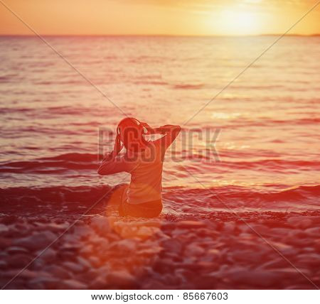 Woman Listening Music On Beach At Sunset