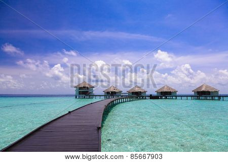 The path to the bungalow over the water