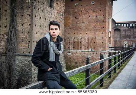 Young Man Outside the Building Looking Away to Left