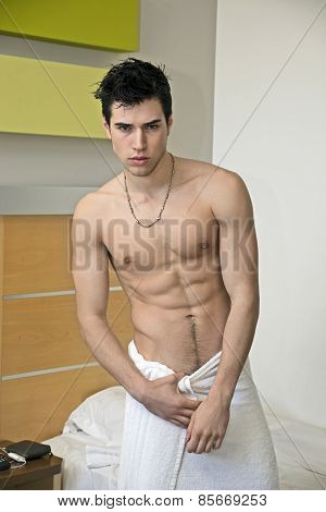 Handsome Young Man In Towel At Home