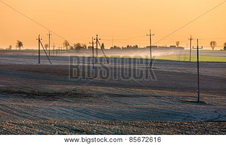 Plowed Field With Power Poles