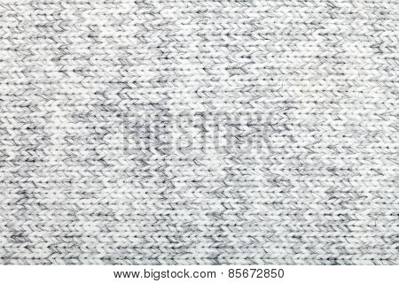 Grey knitted fabric made of heathered yarn textured background