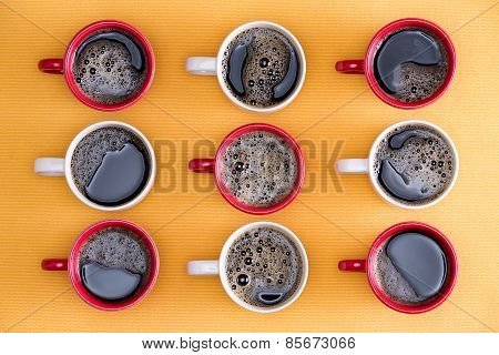 Mugs Of Black Coffee In Alternating Colors