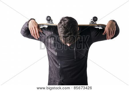 Handsome Young Man With Skateboard Over His Shoulders