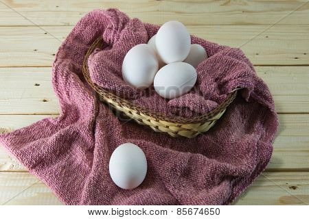 Fresh Eggs In A Woven Basket With Red Dish Towel. Selective Focus On Eggs With Shallow Dof. Concept