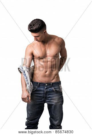 Attractive Trendy Young Man Undressing, Taking Off Shirt