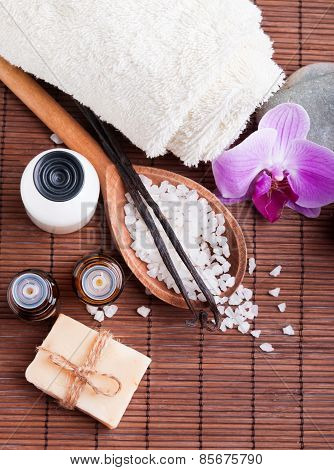 Spa Still Life With Aroma Oils, Sea Salt And Vanilla Pods.
