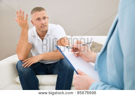 Depressed Patient In Front Of Psychiatrist