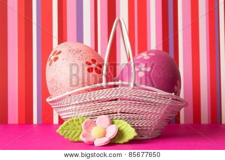 Pink And Crimson Easter Eggs In A Basket With Pink Flower