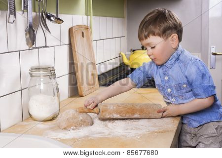 Little Boy Baking In The Kitchen.