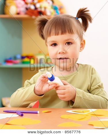 Little Girl Doing Arts And Crafts In Preschool