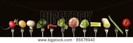 Variation of fresh vegetables on a black background,