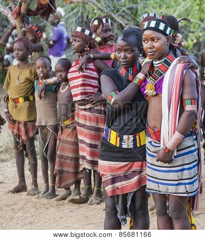 Boys And Girls At The Traditional Evangaty Ceremony. Turmi, Ethiopia