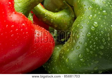 Cut Shot Of Green,red Bell Pepper Background With Water Drops