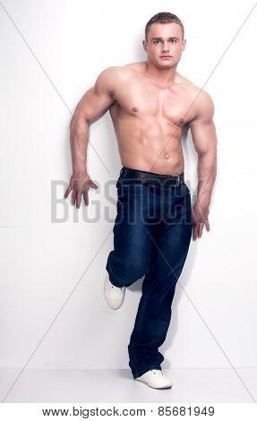 Muscular Bodybuilder In Studio.
