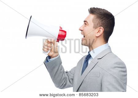 business, people and public announcement concept - happy businessman in suit speaking to megaphone