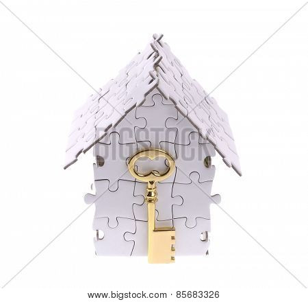 House from puzzle on white with golden key