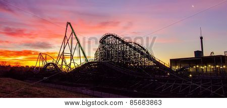 Curves Of A Roller Coaster At Sunset Or Sunrise