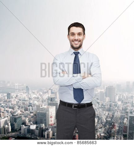 business and office concept - handsome businessman with crossed arms