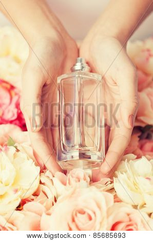 close up of woman's hands showing perfume