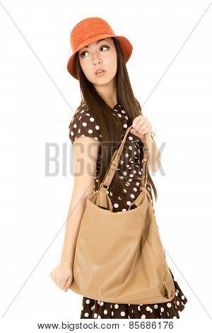 Cute Teen Girl With Her Purse Looking Over Her Shoulder Wearing Orange Hat