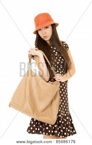 Cute Teen Girl With Purse Looking Into Camera Wearing Polka Dot Dress